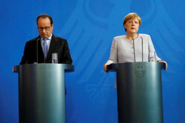Канцлер ФРГ Ангела Меркель и президент Франции Франсуа Олланд на пресс-конференции в Брюсселе