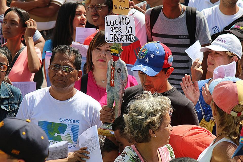 Наш спецкор отправился в Венесуэлу, чтобы понять - как страна раскололась на два лагеря