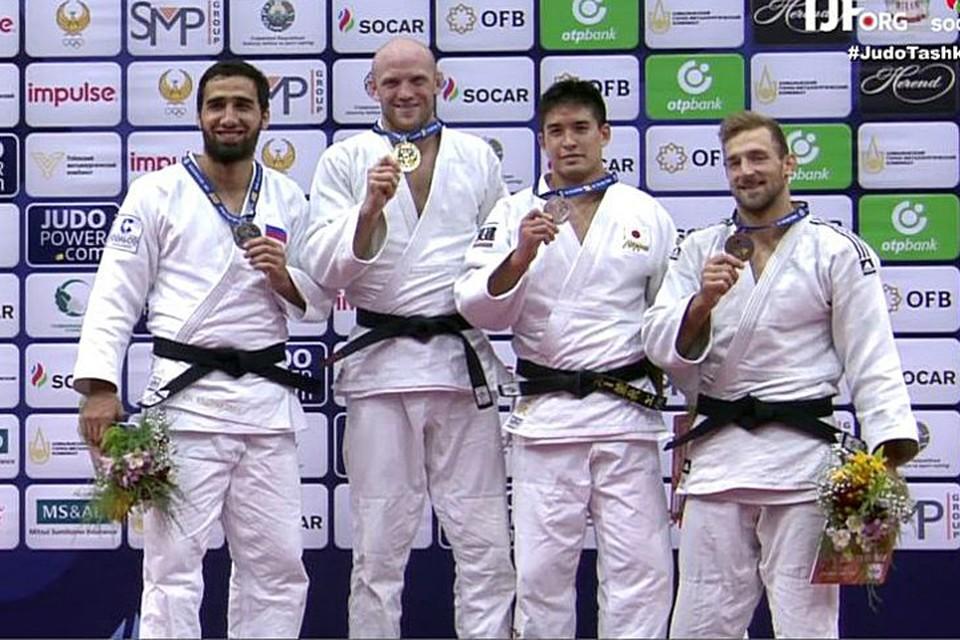 Брат Олимпийского чемпиона - Хасана Халмурзаева - Хусен (слева) - принёс нашей стране серебро