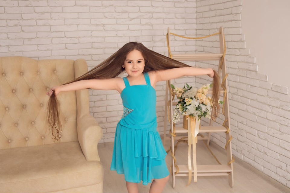 Девочка мечтает растить волосы и дальше. Фото: Марина Серебренникова-Балашова.