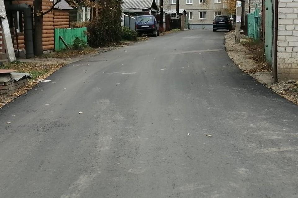 Отремонтированный участок дороги.