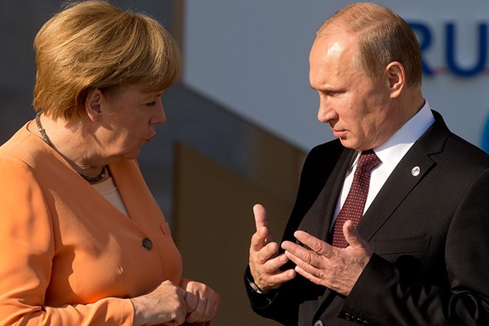 Путин и Ангела Меркель встретились в Италии