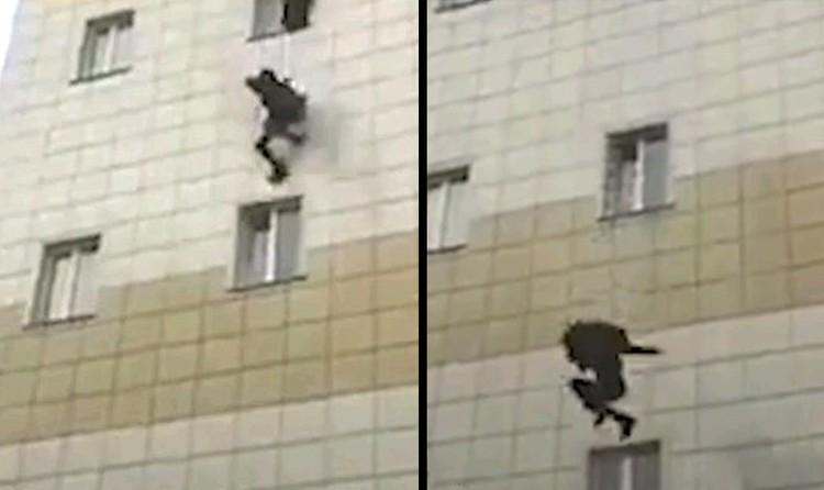 На одном из видео, снятых на месте пожара, мужчина сорвался вниз, пытаясь покинуть горевшее здание через окно.