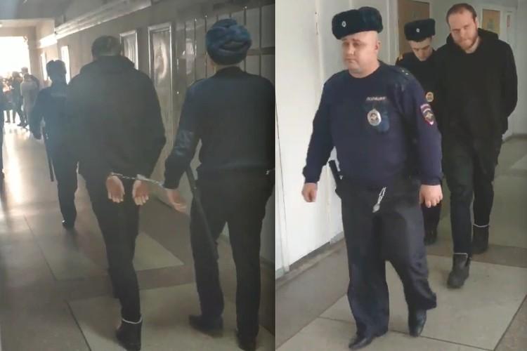 Подозреваемого ведут в зал суда.