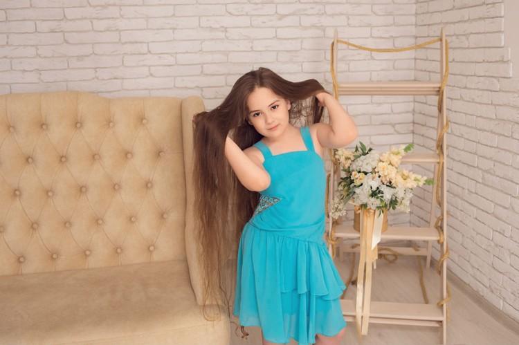 Своими косами девочка гордится. Фото: Марина Серебренникова-Балашова.